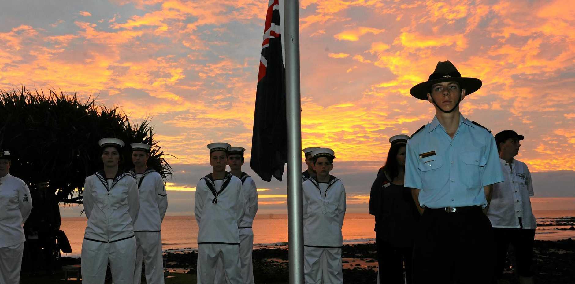 ANZAC DAY: The sun rises at the Bargara Anzac Day Dawn Service. Photo: Max Fleet / NewsMail