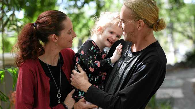 Natasha Moore and Mat Cook with their daughter Lilly. The couple have started a GoFundMe campaign to raise money for a bigger car to transport Lilly.