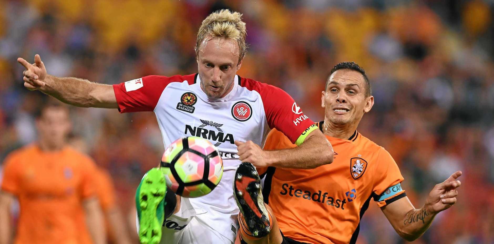 Wanderers player Mitchell Nichols competes with the Roar's Jade North.