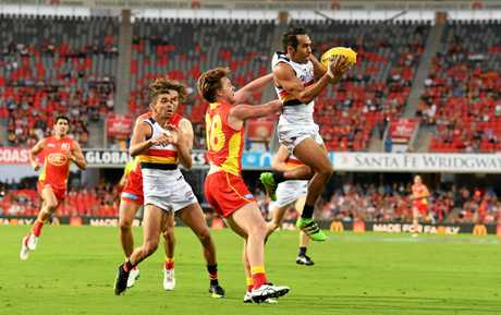 Crows player Eddie Betts takes a mark.