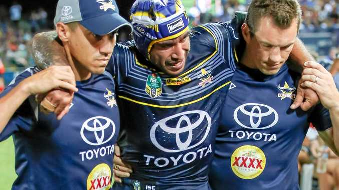 Cowboys star Johnathan Thurston is helped from the field after getting injured.