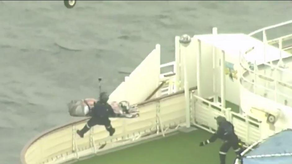 The woman was winched off the ship and flown to hospital.