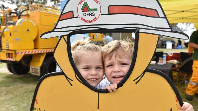 Marcus' Legacy Family Fun Day at Seafront Oval - Oliviah,3, and Atticus,2, Bashford pose at the Rural Fire Brigade stand.