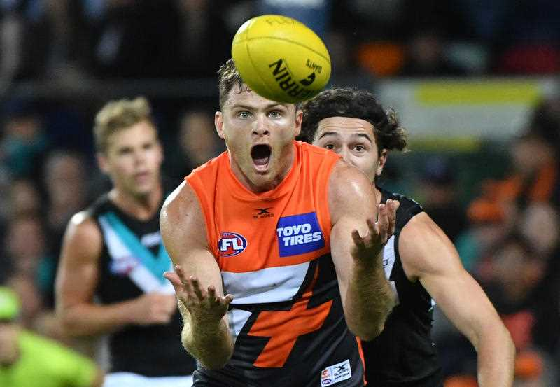 Heath Shaw of the Giants takes a mark during the Round 4 AFL match between the Greater Western Sydney (GWS) Giants and the Port Adelaide Power at Manuka Oval in Canberra, Saturday, April 15, 2017.