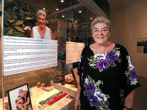 Former midwife Ally Page tells her story in an exhibition at the Tweed Regional Museum in Murwillumbah.