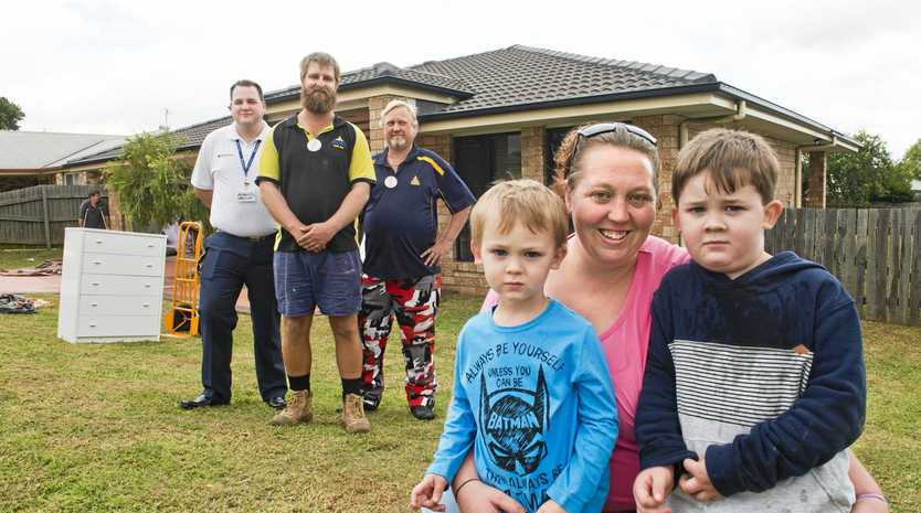 HELPING HAND: Rebecca Rauchle with children Myles (left) and Zander outside their new Toowoomba home with (from left) Brendan Hardy of House Call Doctor, Apex Club of Roma president David Nielsen and Apex Club of Toowoomba president Les Postle.