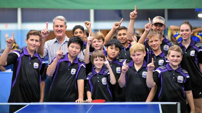 Mackay Mayor Greg Williamson at the Queensland Junior Table Tennis Championship in Mackay yesterday with players (from left) Will Van De Ka, Evan Luo, Brandt Glover, Jack Ma, Albert Gorgeloh, Shaun Hoile, Aseen Rana, Byron Wood, Kylie Hoani-Vincent, Will George and Rebekah Stanley, with coach Mitch Connor.