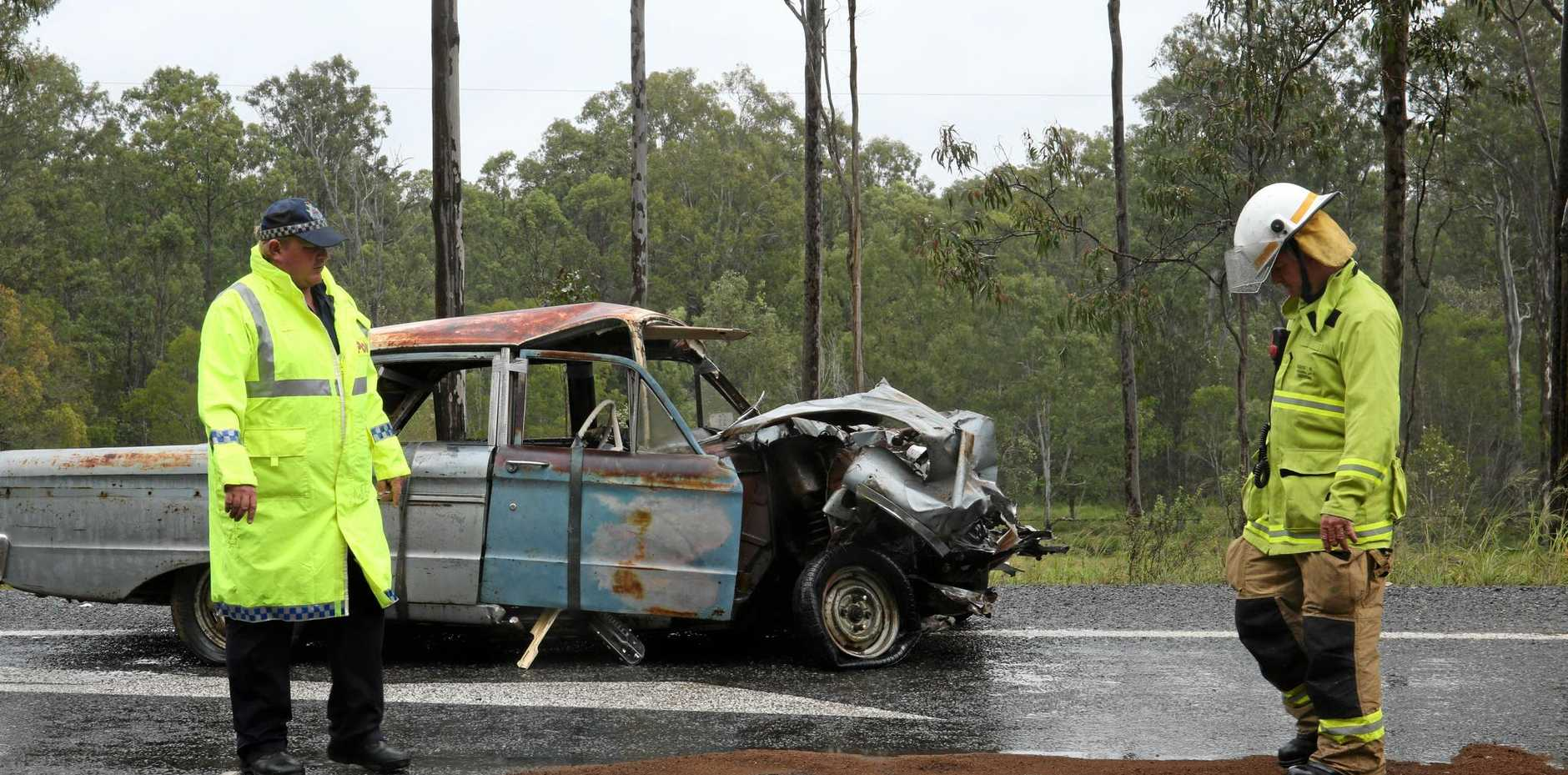 AFTERMATH : Emergency services at the scene of a crash north of Curra on Saturday.