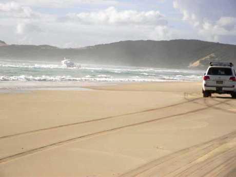 A luxury Riviera cruiser has been run aground on Fraser Island after taking water overnight.