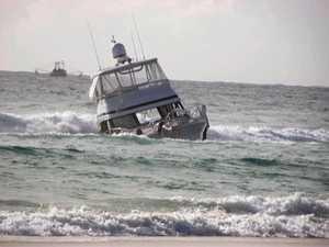Pleasure craft aground on Fraser Island after sinking drama