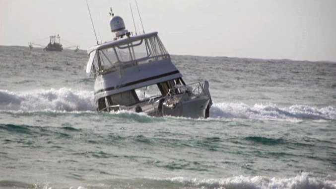 ISLAND EMERGENCY: A luxury Riviera cruiser has been run aground on Fraser Island after taking water overnight.