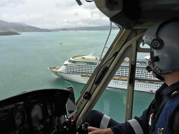 The rescue chopper orbiting the cruise ship.