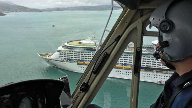 The rescue chopper orbiting the cruise ship.