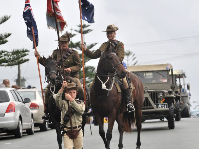 Anzac Day march and service at Caloundra: Ben Turner, 9, leads the Maleny Light Horse to commence the march. Photo: Brett Wortman / Sunshine Coast Daily