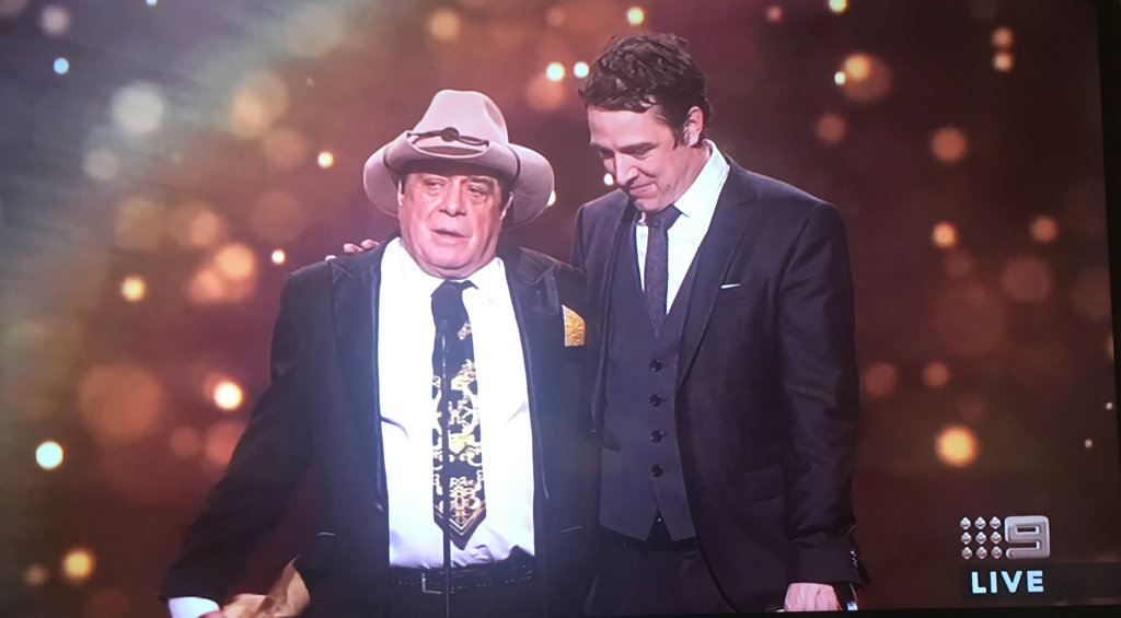 Samuel Johnson on the stage with Molly Meldrum.