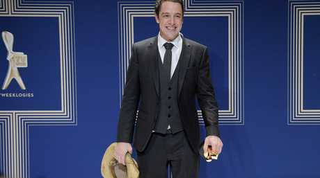 Samuel Johnson with his Gold Logie and gold Akubra.