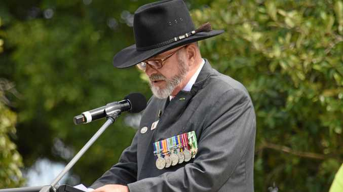 LEST WE FORGET: Gatton RSL president Les Nash reads the list of First World War fallen at Gatton's 2016 Anzac Day service.