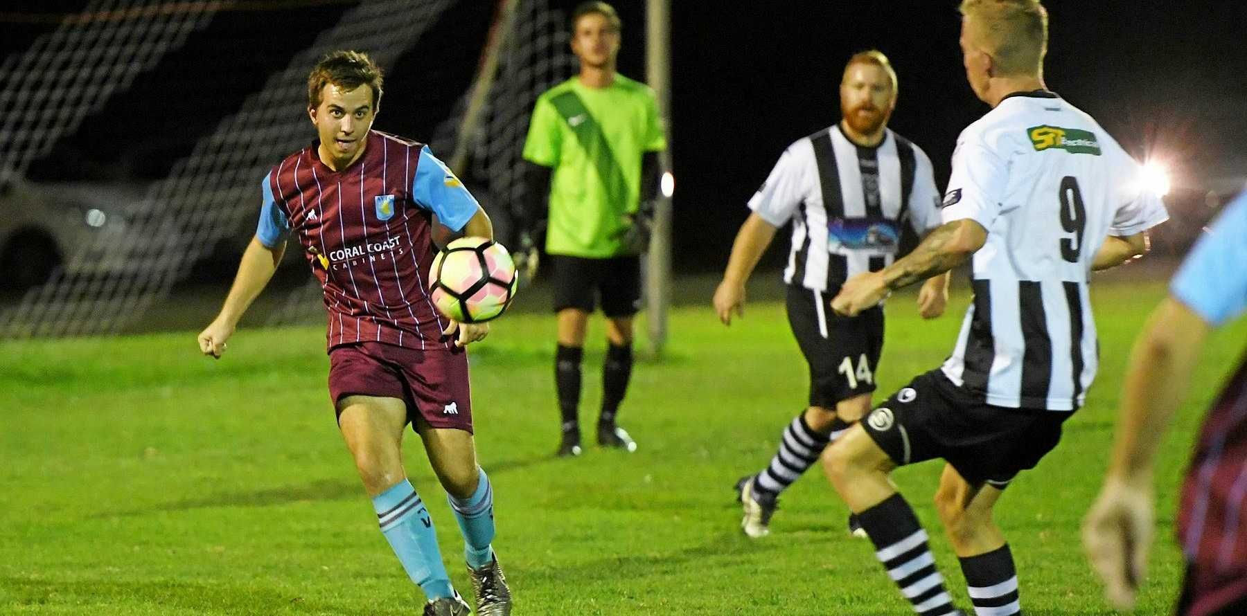 CLEARANCE: Brothers Aston Villa's Scott Sommer kicks the ball away from Bingera in Bundaberg.
