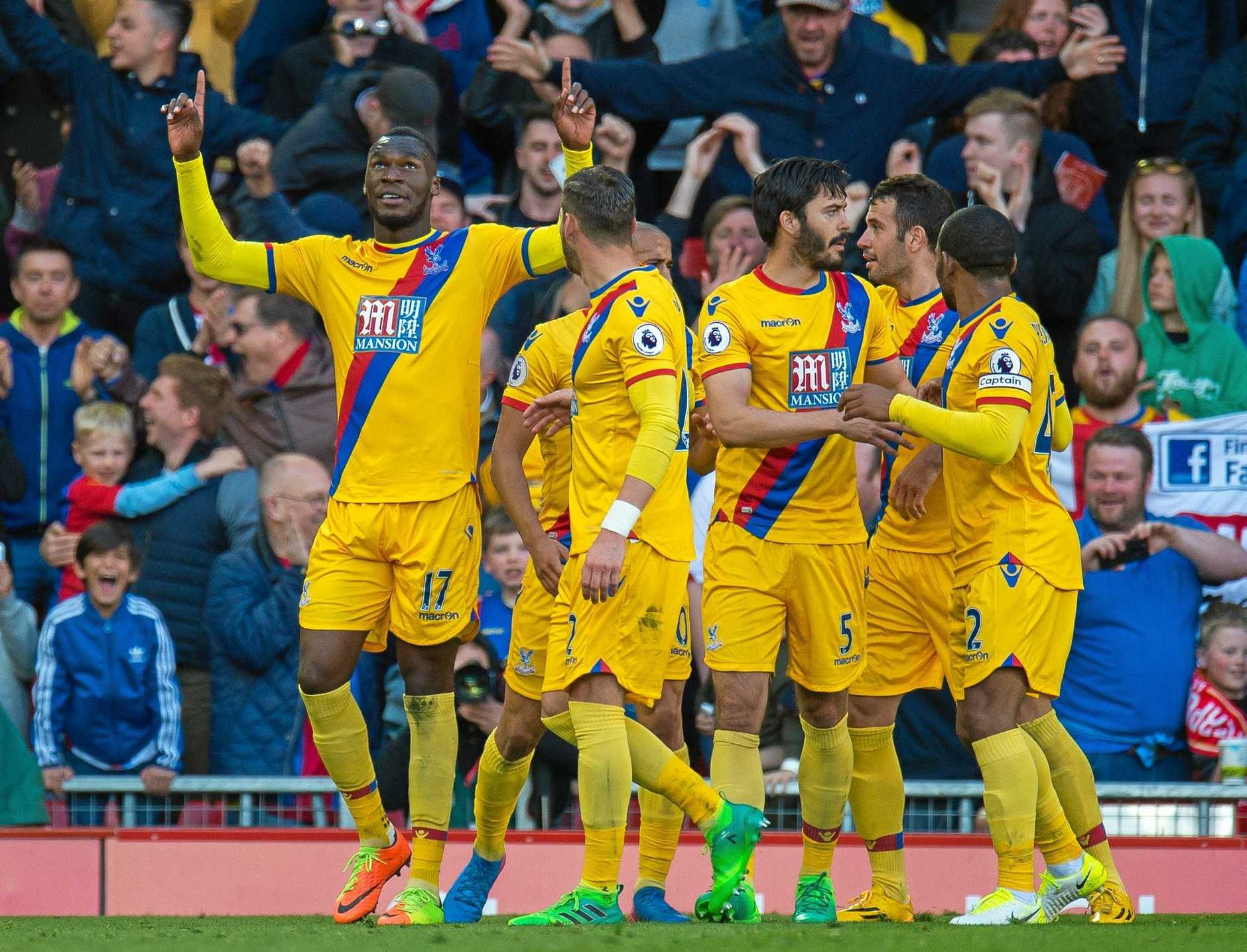 Crystal Palace's Christian Benteke (L) celebrates scoring his second goal in the 2-1 win over Liverpool.