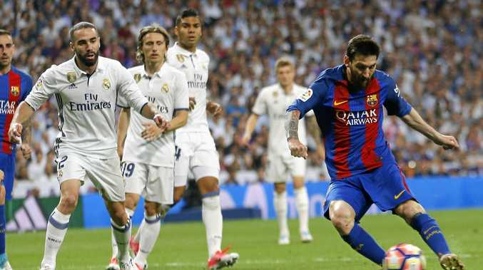 Barcelona's Lionel Messi scores the winner in the 3-2 victory over Real Madrid.