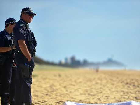**WARNING DECEASED BODY**POLICE are working to identify a man, dressed in fishing gear, whose body was found on the beach at Warana this morning.The man, who officers believe is aged in his 50s, was found by walkers near Palkana Park, Warana, shortly before 6am. Photo: Che Chapman / Sunshine Coast