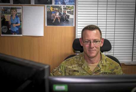 Royal Australian Air Force airman Corporal Ben Reed, from Gympie, processes administration paperwork at Australia's main operating base in the Middle East region.