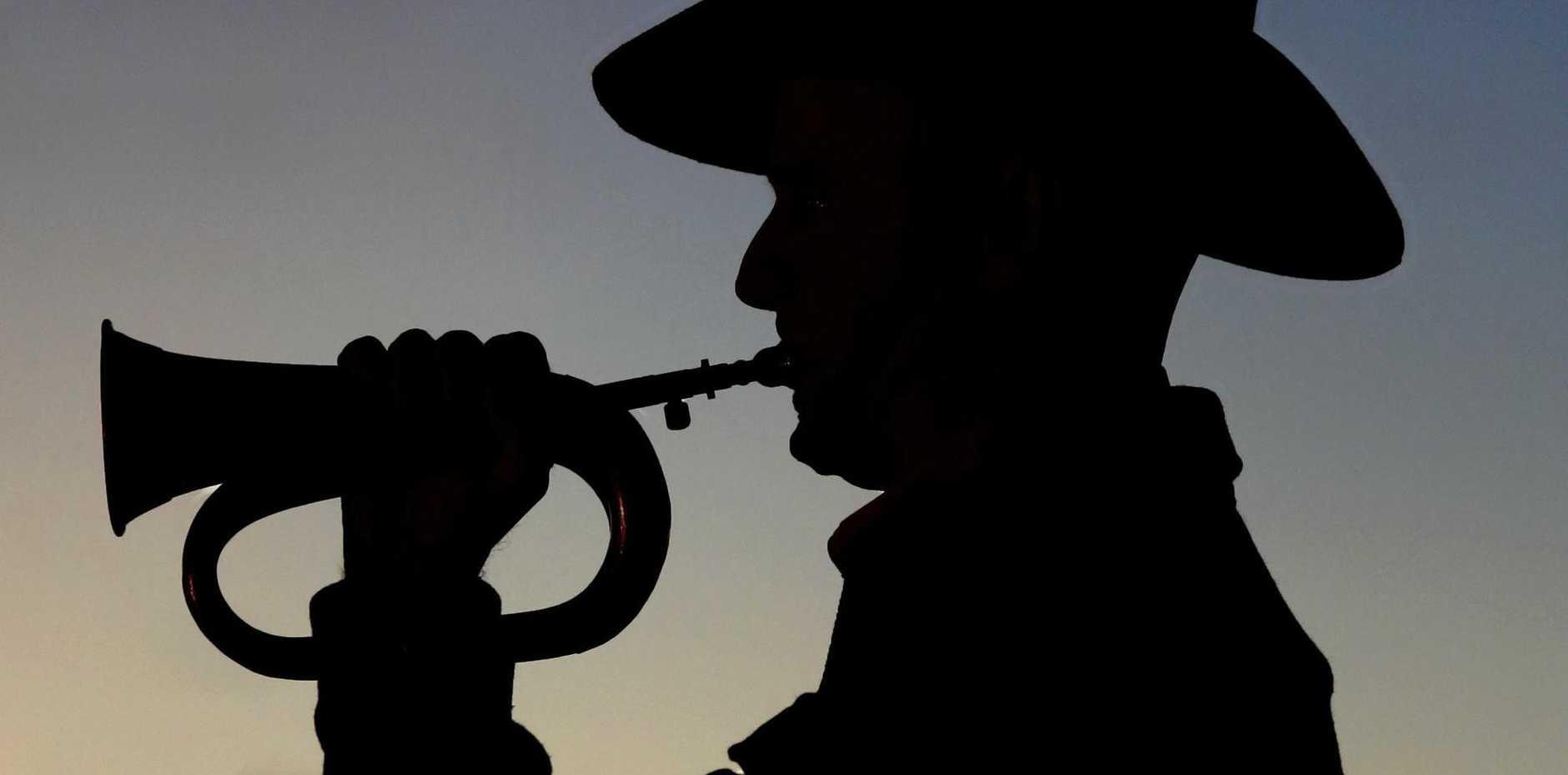 Bugler plays at a dawn service.