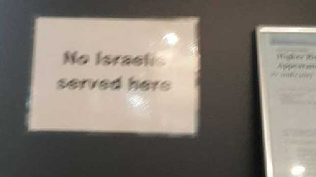 Mohr Wenger, an Israeli backpacker, was allegedly turned away by a Cairns piercing salon, which has a sign,