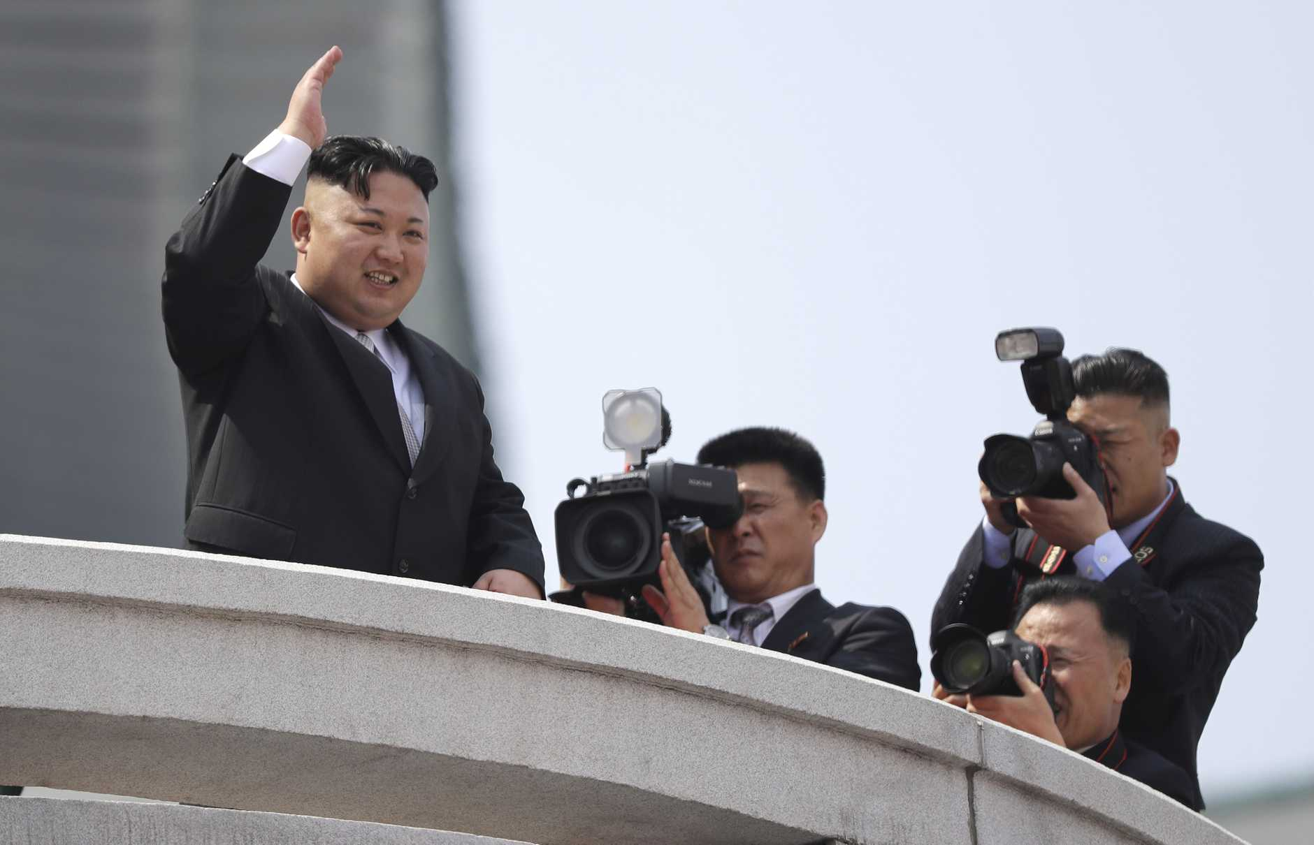 North Korean leader Kim Jong Un waves during a military parade on Saturday, April 15, 2017, in Pyongyang, North Korea to celebrate the 105th birth anniversary of Kim Il Sung, the country's late founder and grandfather of current ruler Kim Jong Un. (AP Photo/Wong Maye-E)