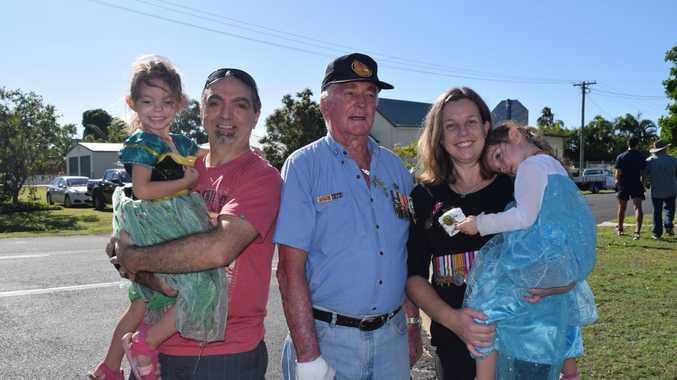 BURRUM SERVICE: (L) Peter Imbesi holding daughter Zoe with veteran Warren Dries and his daughter Carly Imbesi with Natalie Imbesi.