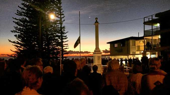NEW DAWN: Residents from Yamba and surrounds paid their respects at the dawn Anzac Day service at the Main Beach cenotaph.