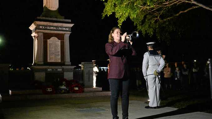 Bugler Kate Brown plays the Last Post at the Mackay Anzac Day dawn service.