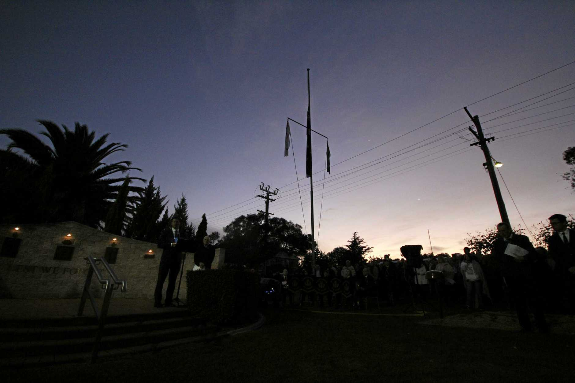 The first light creeps in on the Stanthorpe Dawn Service on Anzac Day 2017.