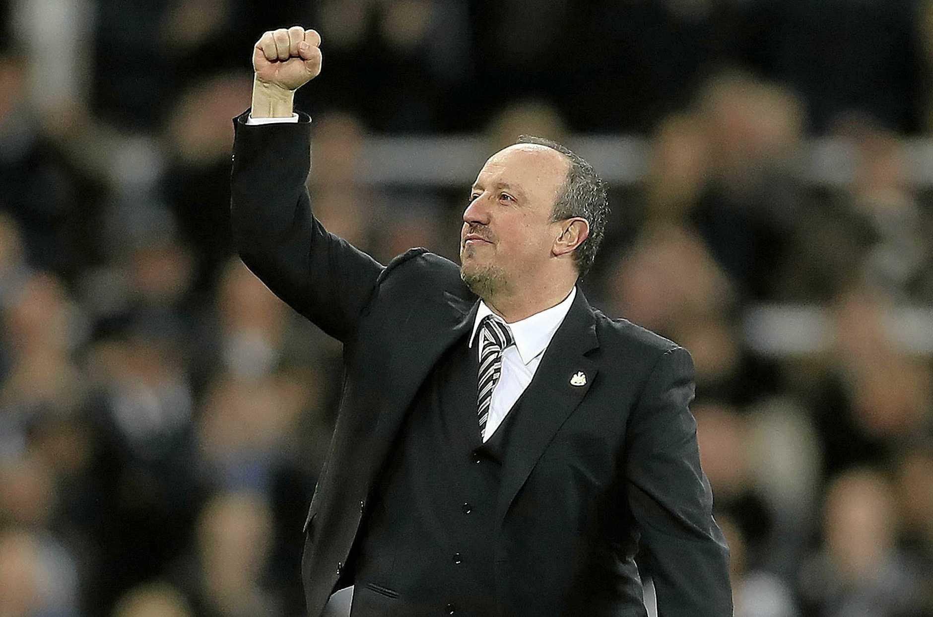 Newcastle United manager Rafael Benitez celebrates promotion.