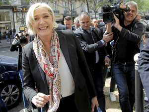Le Pen takes step back to lift appeal