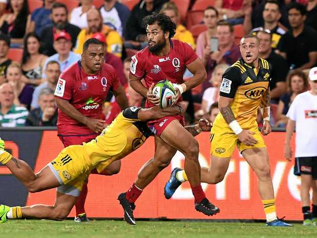Reds player Karmichael Hunt playing against the Hurricanes.