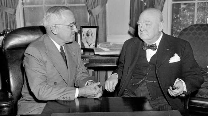 British Prime Minister Winston Churchill sits in US President Truman's White House office in 1952. (AP Photo)