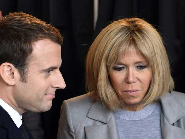French centrist presidential election candidate Emmanuel Macron, center left, and his wife Brigitte queue to vote in the first round of the presidential election in Le Touquet, northern France, Sunday April 23, 2017. (Philippe Wojazer, Pool photo via AP)