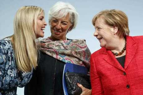 US President Trump's assistant and daughter Ivanka Trump (L), Managing Director of the International Monetary Fund (IMF) Christine Lagarde (C), and German Chancellor Angela Merkel (R) say their farewells after holding a panel discussion 'Inspiring women: Scaling Up Women's Entrepreneurship' at the W20 Summit in Berlin