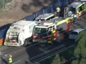 Garbage truck collides with ambulance