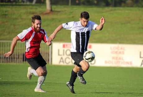 Byron's Gianluca Bongiovann gets away.