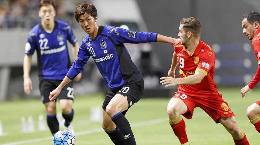 Action from Adelaide's 3-3 draw against Gamba Osaka.