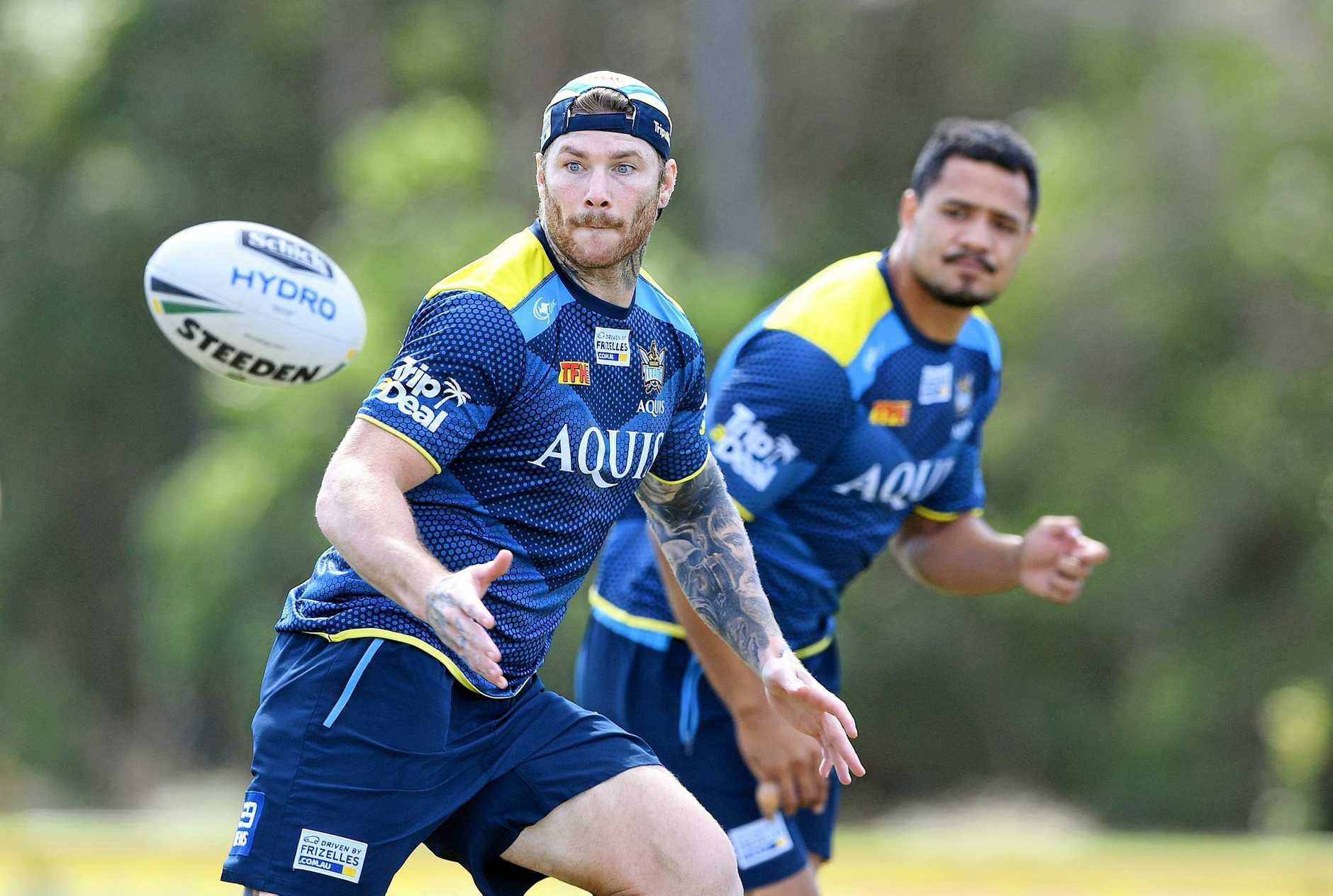 Chris McQueen receives the ball during the Gold Coast Titans training session