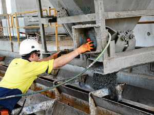 A worker pours concrete in to a pile mould.
