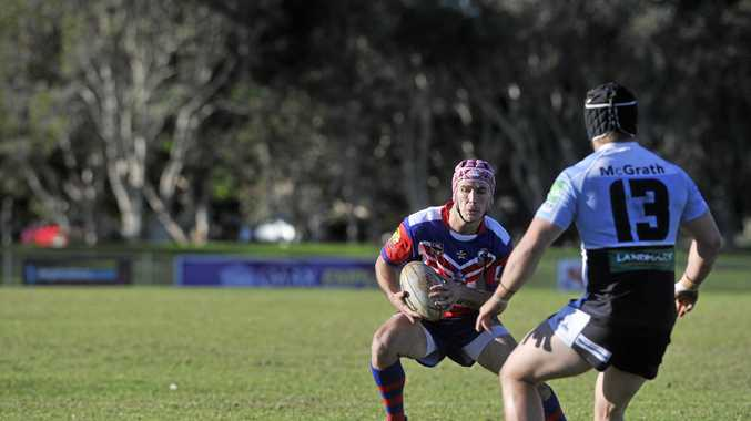 Kyogle player Sam Nicholson tries to avoid the Ballina defence during the game at Kingsford Smith Park in Ballina. Photo Marc Stapelberg / The Northern Star