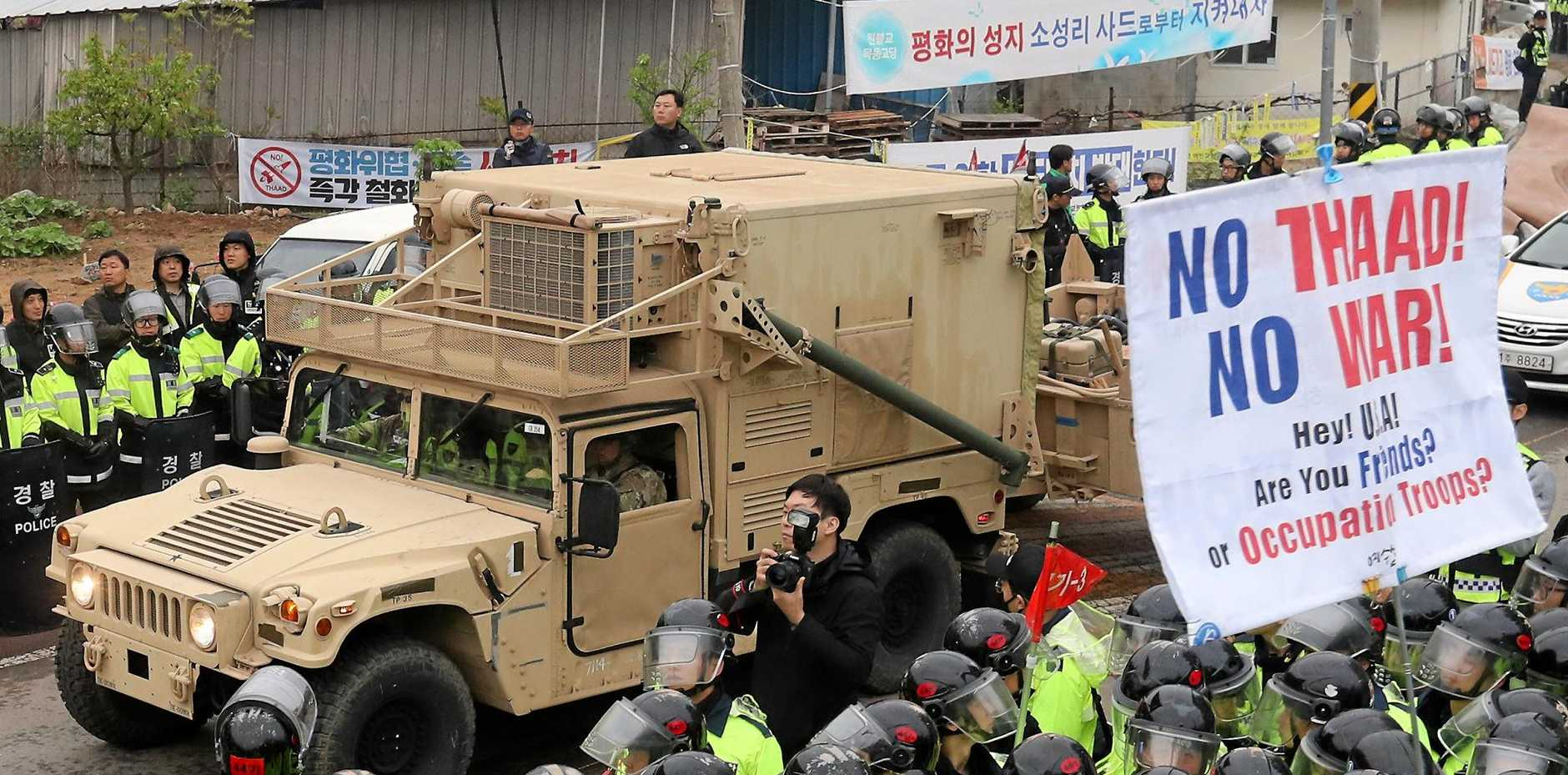 A US military trailer carrying elements of the Terminal High Altitude Area Defecse system enters a golf course in Seongju, South Korea.