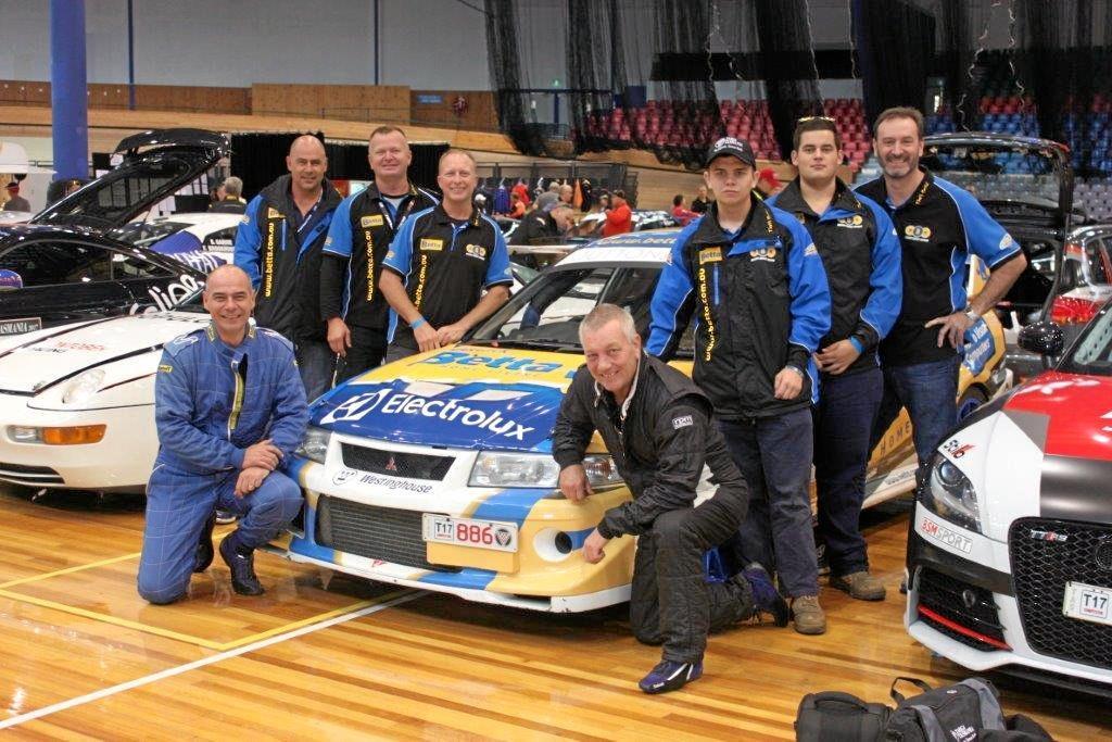 TEAM WORK: Team Betta Warwick crew (back, from left) Gerard Balint, Troy Perrins, Peter Bridson, Nicholas Lane, Chris Balint, Michael Plant, (front) Rob Balint (driver) and Peter Lane (navigator) at Targa Tasmania.