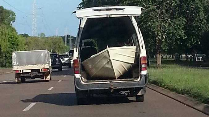 A motorist carried a boat in the back of a van while driving on Vanderlin Dr in Darwin.