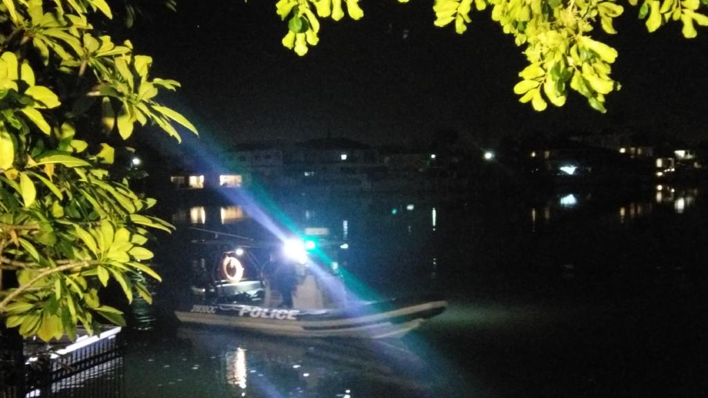 A police boat searches the canal at Chevron Island.