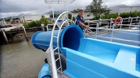 Sunlover Cruises' Chief Engineer with Sunlover Cruises' new two-storey reef pontoon that sports a water slide and will be placed at Moore Reef. PICTURE: STEWART McLEAN